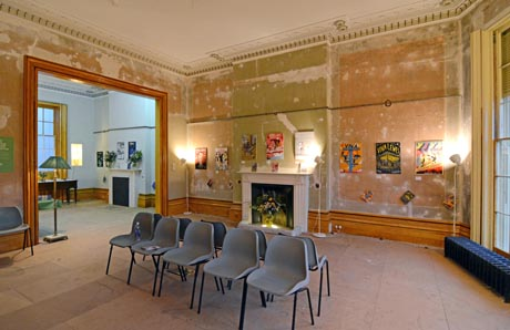 View of drawing room showing exhibition of Viva magazine covers
