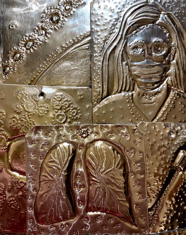Shiny metal pieces embossed with designs, including those representing coronavirus and a health worker wearing a mask