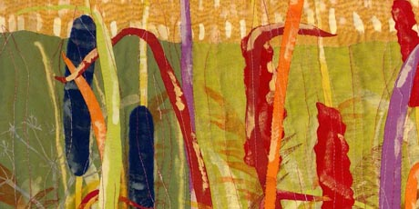 Detail of tapestry showing abstract scenery in yellow, orange and red