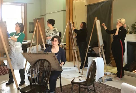 Artists working at their easels in a large, Regency room