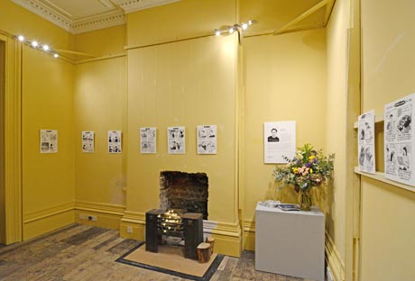 View of parlour showing exhibition of Viva cartoon artworks