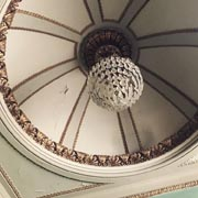 Photograph of domed ceiling with chandelier.