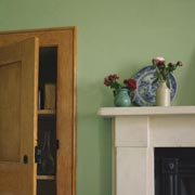 Photo of the fireplace and cupboard in our Housekeeper's Room