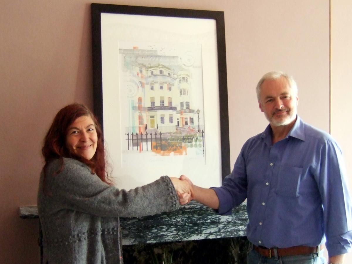 Raffle winner Gill Rosenberg collecting the Sarah Jones's Regency Town House print pictured with Nick Tyson
